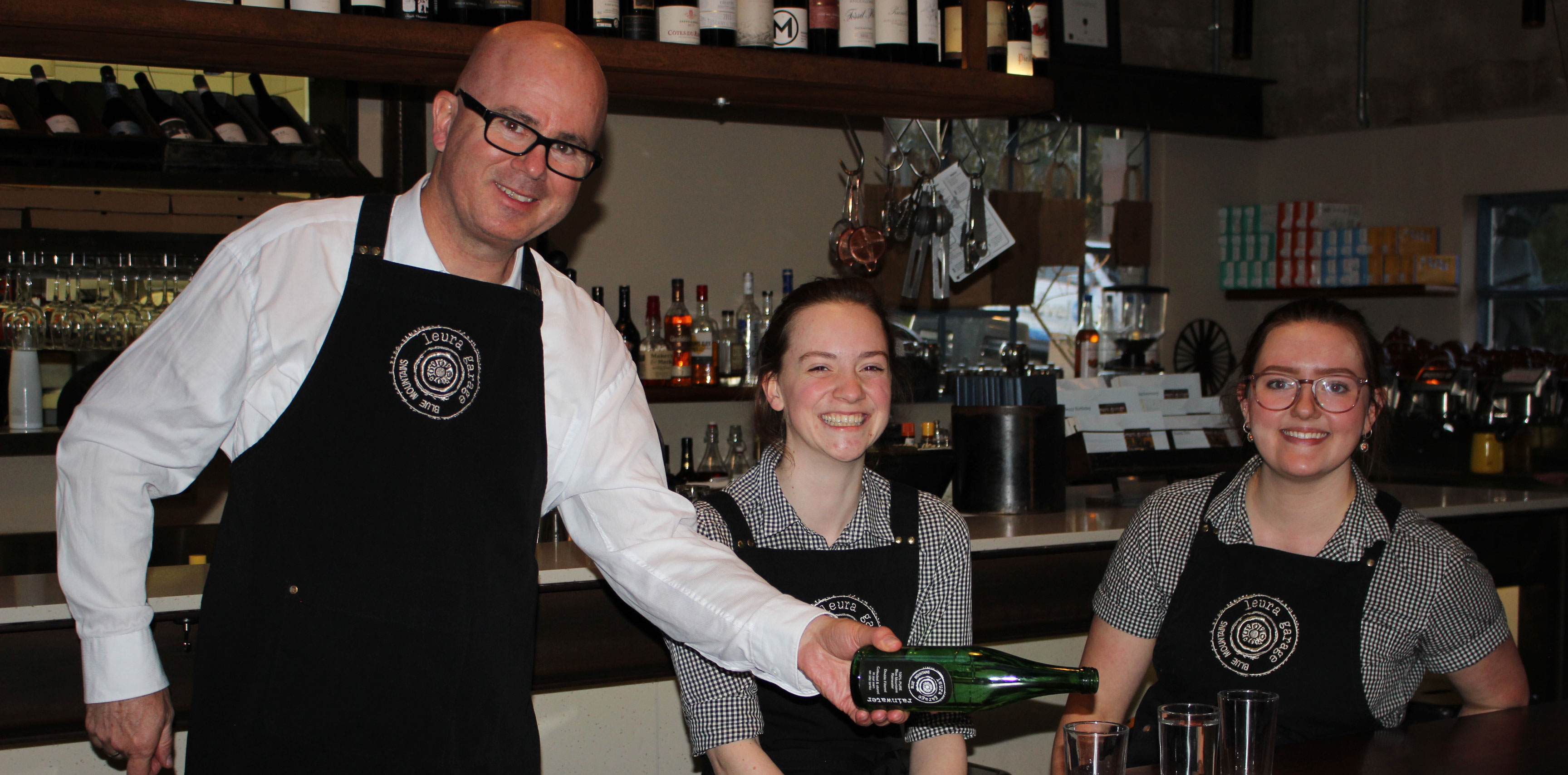Mayor Mark Greenhill with Caitlin Schultz and Beth Coggins, at Leura Garage Café and Restaurant, which is featured in the experience trails.