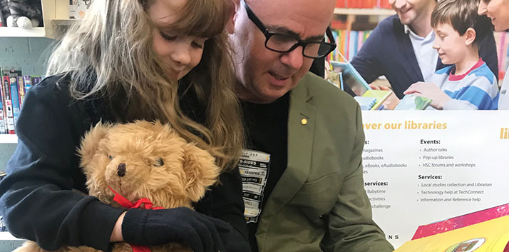 Mayor Mark Greenhill reading with his daughter